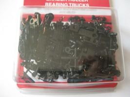 Micro-Trains Stock #00310044  (1038-10) Roller Bearing Trucks Long Couplers image 1