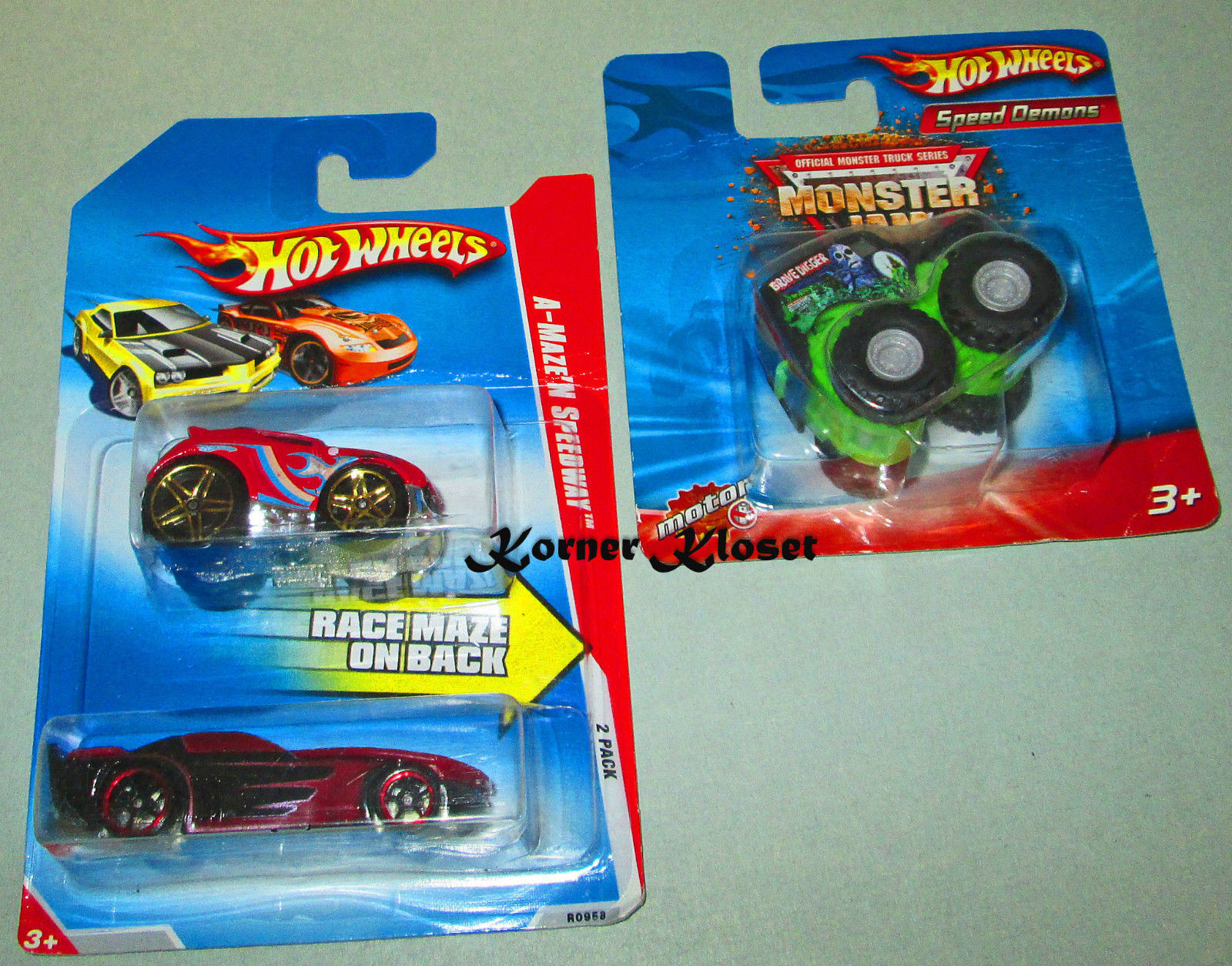 Primary image for Mattel Hot Wheels Grave Digger Monster Truck & A-Maze'n Speedway 2 Pack Cars-NIP