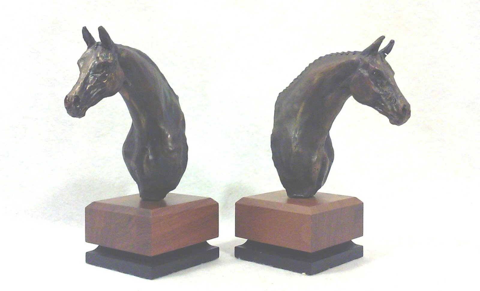 Bronze horse bookends on ebony and rosewood bases angle