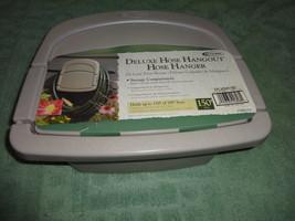 SUNCAST Deluxe Hose Hangout garden hose caddy with Storage Compartment - $9.00
