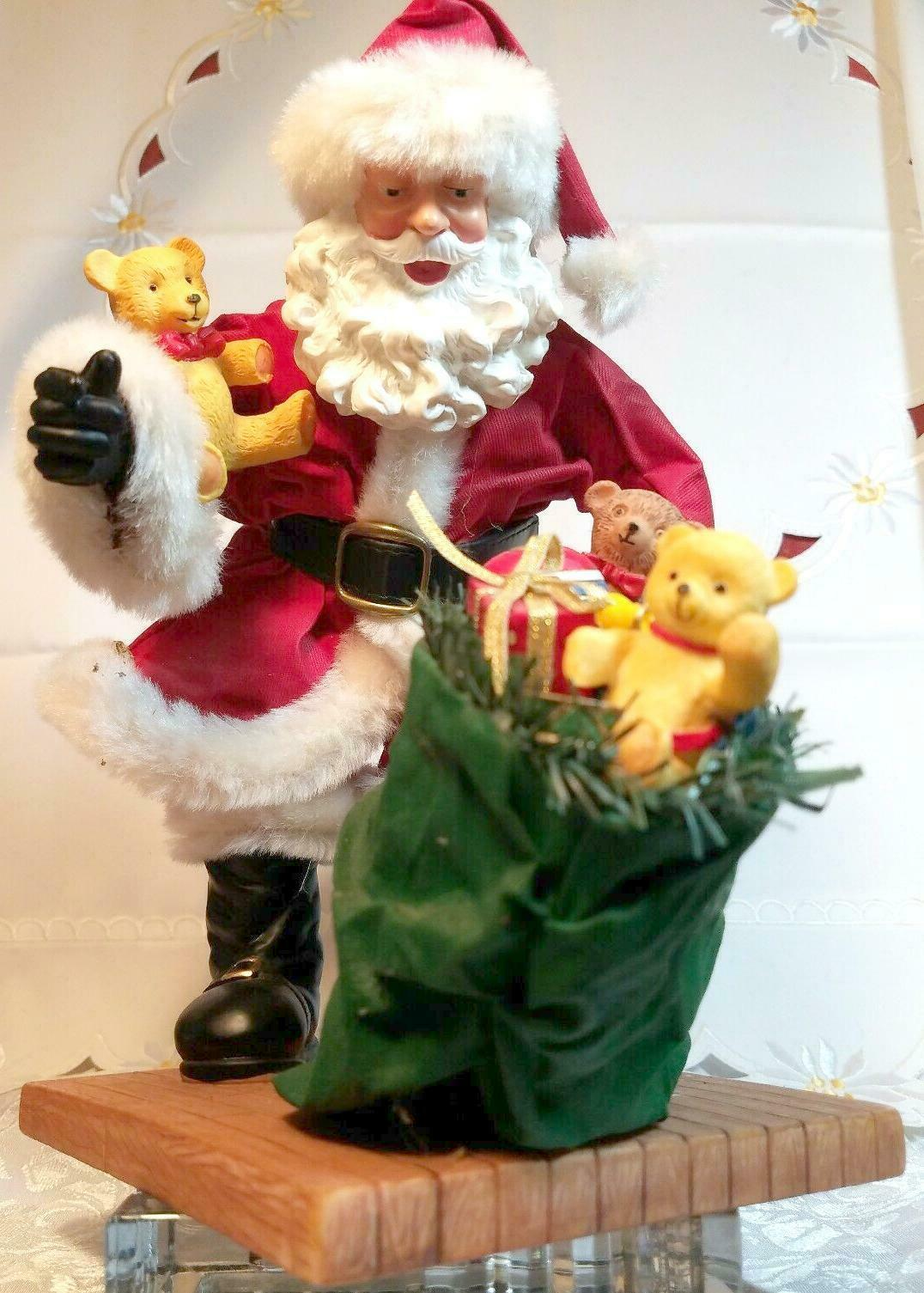 "VINTAGE SANTA CLAUS WITH BAG OF TOYS ON HEAVY CERAMIC FLOOR BASE -  10""X10"""