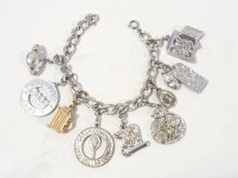 Vintage sterling silver bracelet with 9 charm/pendant 7'' Long - $45.00