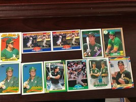 11 Jose Canseco vintage baseball cards - $25.00