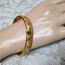 Elegant, Gold 1/2-inch W Embossed Floral Design Size M- 7 1/2 C Bangle B... - $14.20
