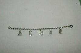 vintage SOUTHWEST SW Charm Bracelet silvertone Headress Teepee Papoose Bow Arrow - $19.75
