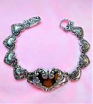 "Silver metal hearts filigree bracelet 7"" - $25.00"