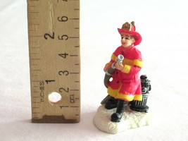 Christmas Village Figure Figurine Fire man Fighter Hydrant Water Hose Re... - $9.99
