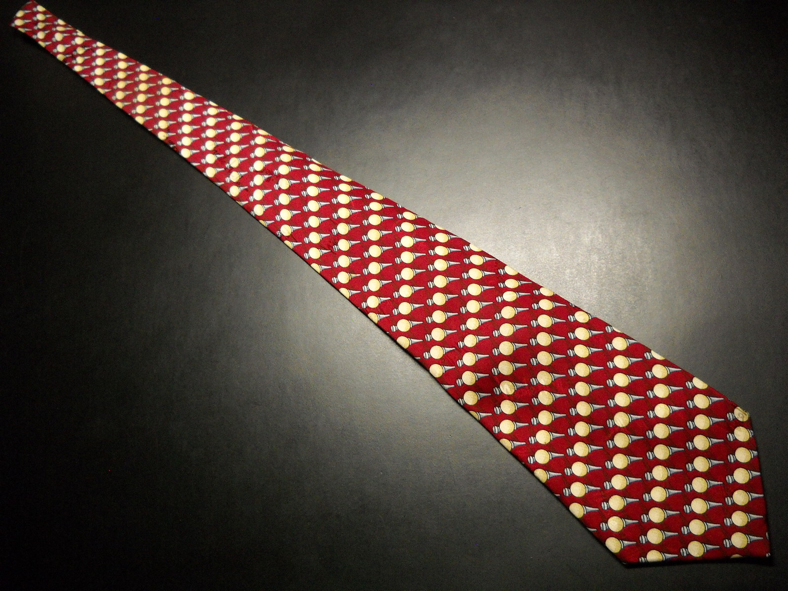 Nicole Miller Neck Tie Repeating Golf Tees Creams Grays Bright Red Background