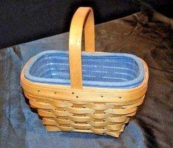 Center-handled Longaberger 2002 Basket with blue cloth and plastic linerAA18- - $49.95