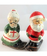Santa and Mrs Claus on skis Christmas holiday salt pepper shaker set Japan - $14.89