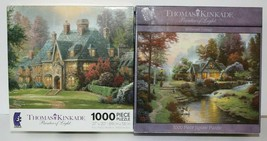 Lot of 2 1000 piece Thomas Kinkade puzzles - $11.64