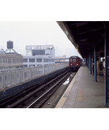 Elevated subway train arrives at a station in Brooklyn New York Photo Print - $8.81+