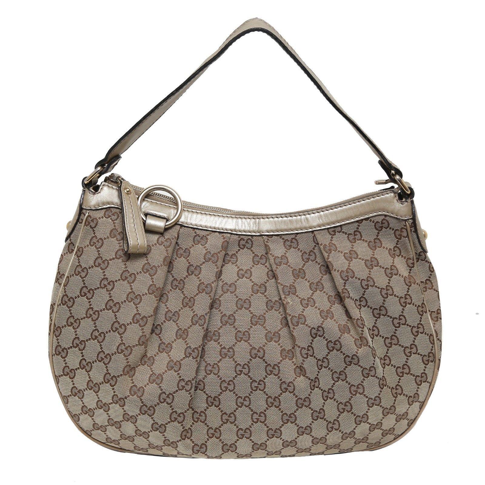 660bfb32b6e 57. 57. Previous. Auth Gucci Beige GG Monogram Canvas Sukey Hobo Leather  Trim Handbag MSRP 945