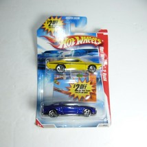 Hot Wheels 2008 2-Pack 71 dodge deman '10 ford mustang GT - $9.89