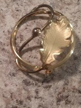 Vintage gold tone. Leaf Pattern In A Circle Brooch. CR CO signed - $7.91