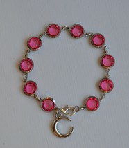 Handmade pink glass bead with moon charm bracelet - $10.50