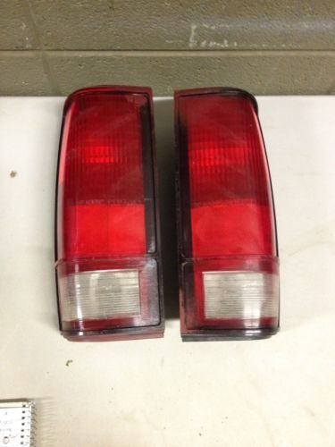 Primary image for 1982-1993 Chevrolet S10 S15 Blazer Jimmy Pair tail light OEM 16501241 16501242