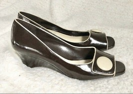 Etienne Aigner brown patent leather wedges with contrasting piping around the ed - $35.64