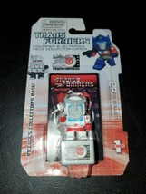 Hasbro Transformers Figurines & 3D Puzzle Piece Collector Cards Ratchet ... - $9.85