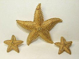 VINTAGE MONET DESIGNER GOLD TONE STARFISH BROOCH AND CLIP ON EARRING SET - $24.70