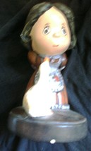 Ceramic Girl With Her Pet Duck - $2.07