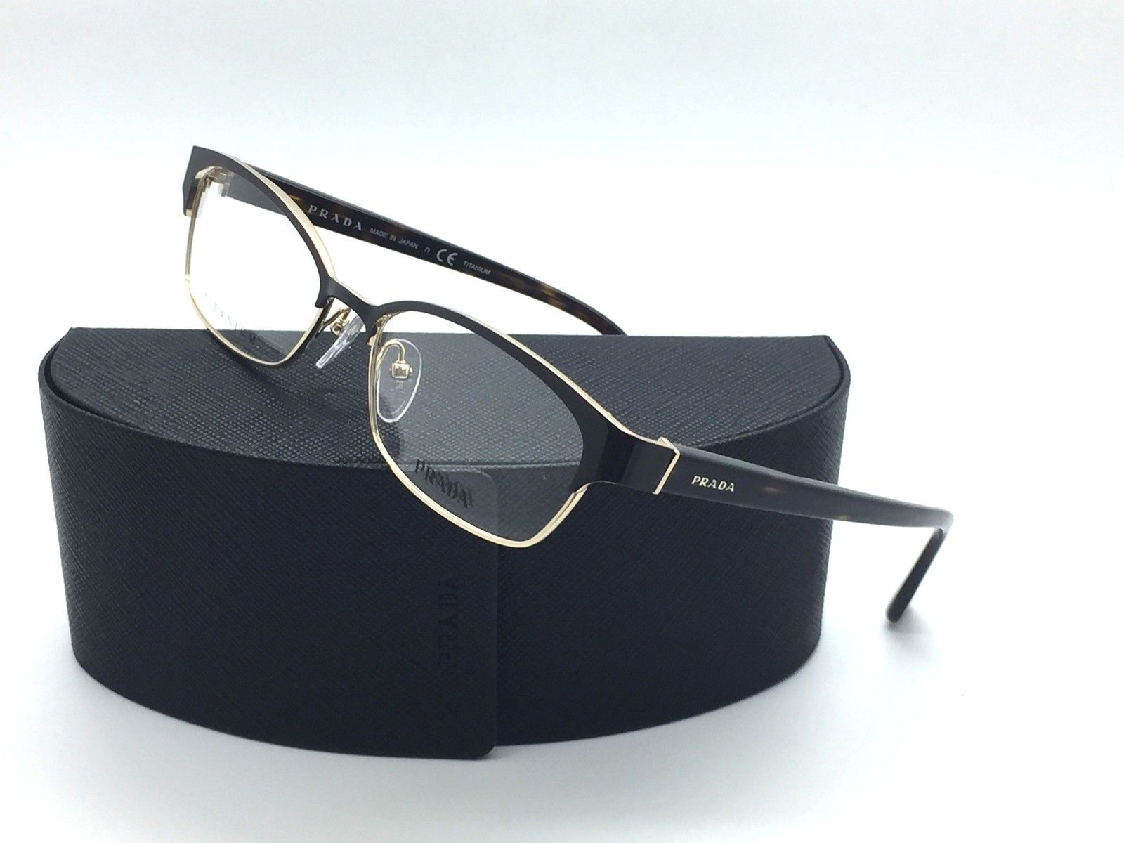 b4ff92eb88ee Prada Gold metal Shiny Black Eyeglasses VPR and 50 similar items. S l1600