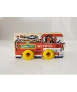 RARE! VINTAGE SESAME STREET FIRE TRUCKS SHAPED BOOK W WHEELS 1988 MUPPET... - $9.89
