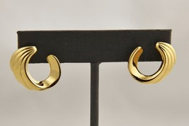 80s VINTAGE Jewelry MONET SIGNED GOLD PLATE PIERCED WAVE EARRINGS - $10.00