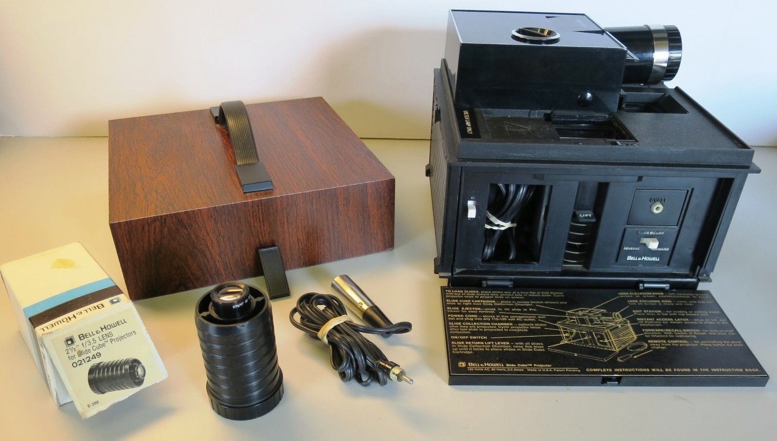 bell and howell slide cube projector wremote and slide case extra lense