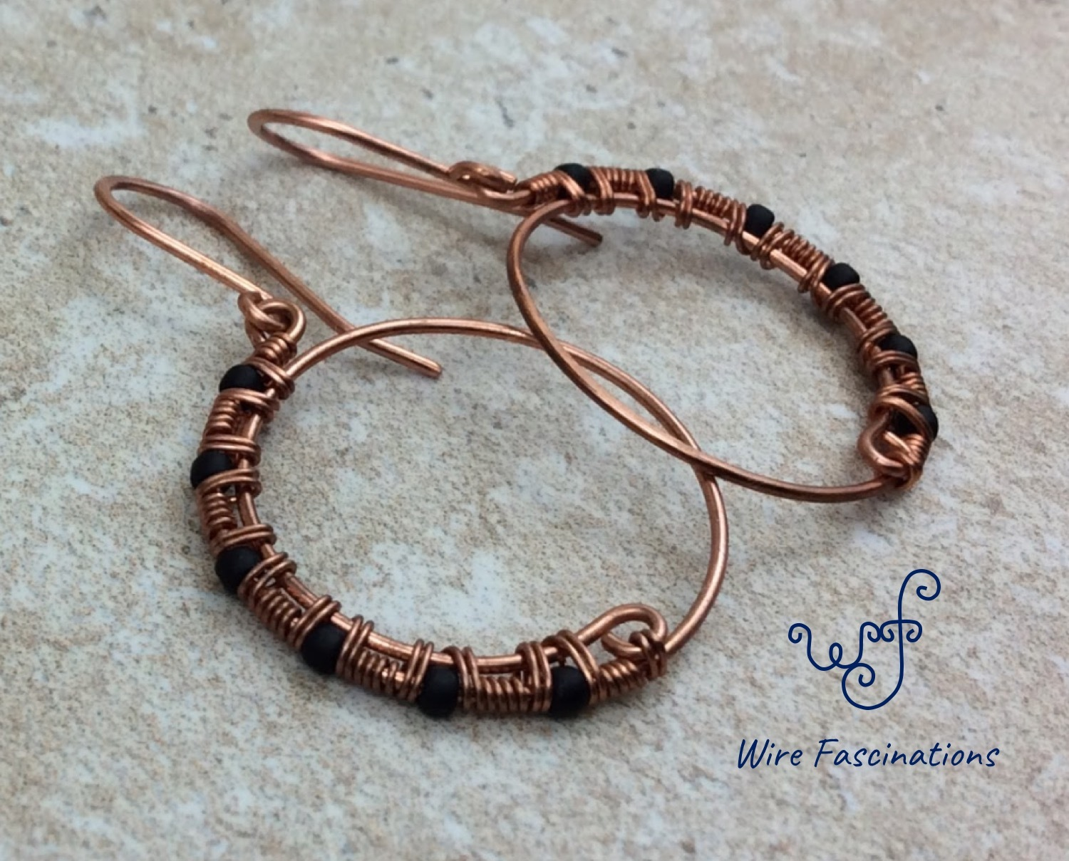 Handmade copper earrings: hoops half wire wrapped with matte black glass beads