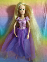 Disney Store Articulated Rapunzel Doll Dressed / No Shoes - $14.83