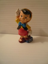"""Vintage Disney Rubber Pinocchio 3"""" Figure Standing on Books Pointing up - $5.45"""