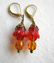 Handcrafted earrings with red lucite flowers, fire-polished glass and br... - $24.00