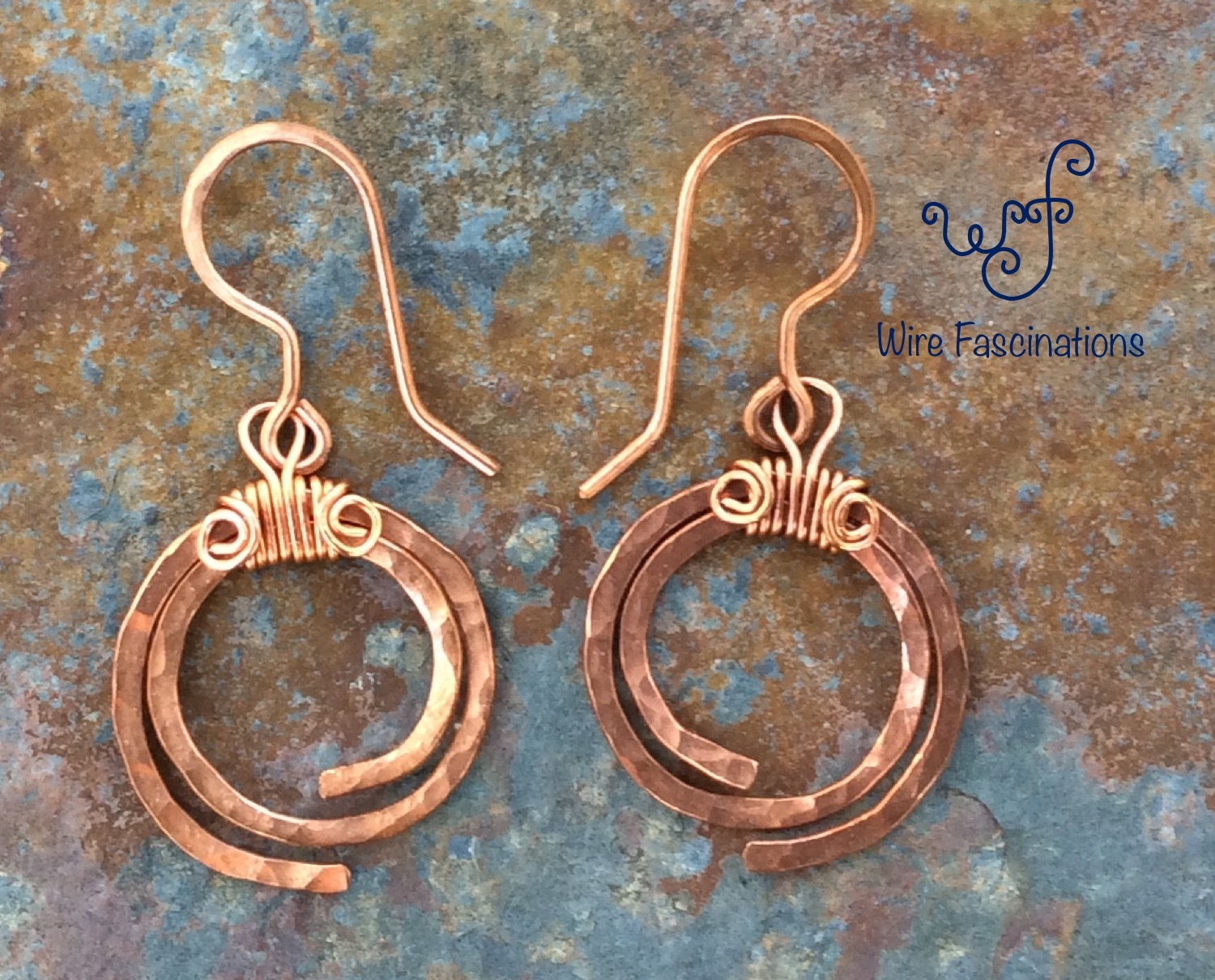 Handmade copper earrings hammered spirals main2