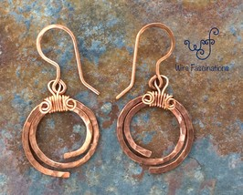 Handmade copper earrings: hammered spirals - $25.00