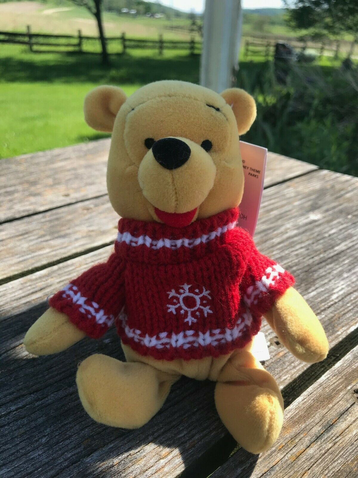 Primary image for Disney Store Small Snowflake Sweater Winnie The POOH Plush Stuffed Animal  - 7.5
