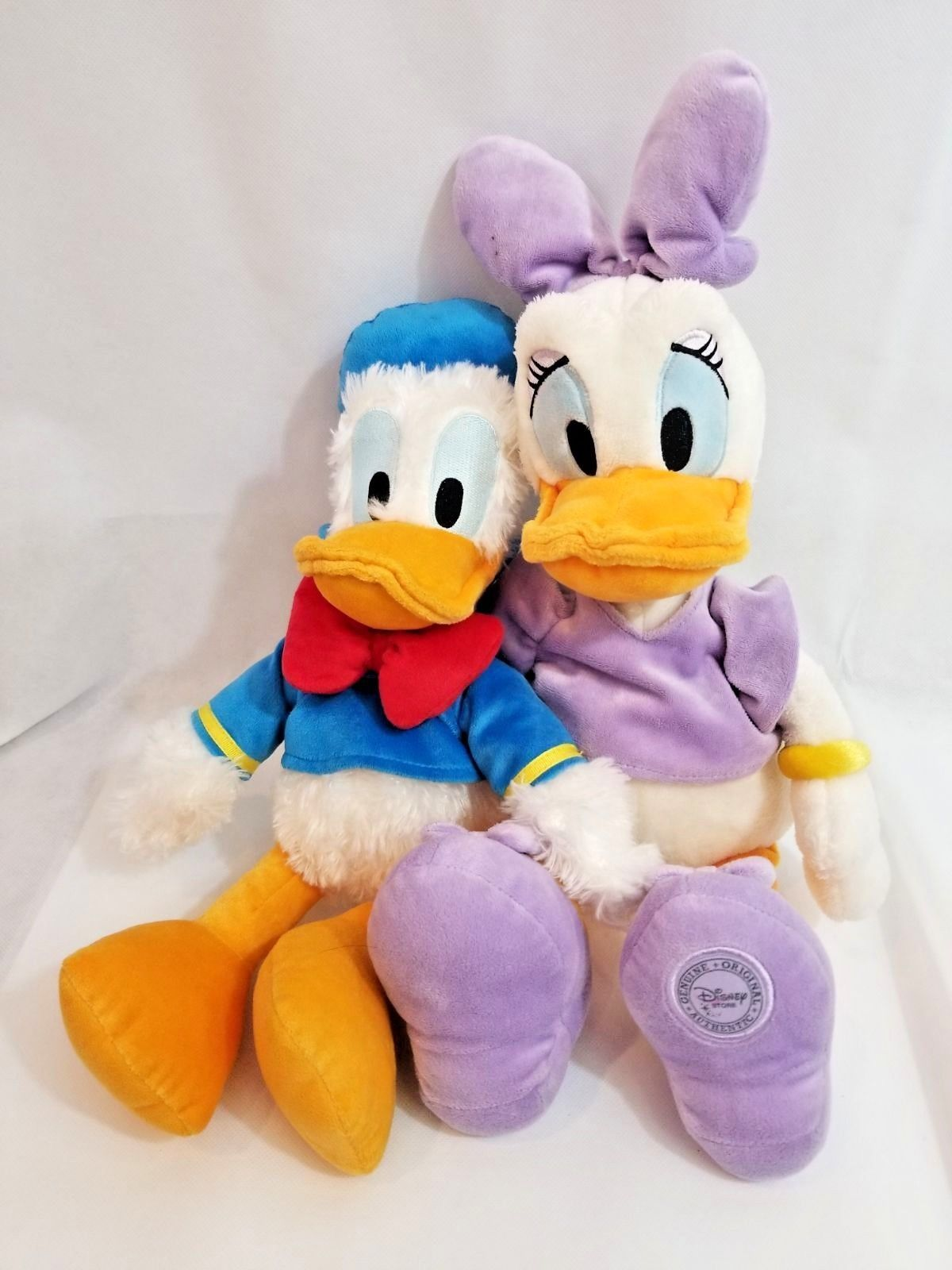 The Disney Store And Parks large Plush Donald Duck and Genuine Authentic Daisy