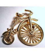 Bicycle with large wheel vintage gold tone brooch or pin - $25.00