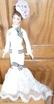 CE BARBIE Doll brunette has eyelashes wearing white gown with hat & gloves - $63.99