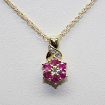 14KT YELLOW GOLD RUBY AND DIAMOND FLOWER NECKLACE #99842-19A - $126.70