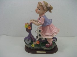 Victoria Collection J&J Resin Figurine Little Girl On Scooter On Wood Stand - $24.70