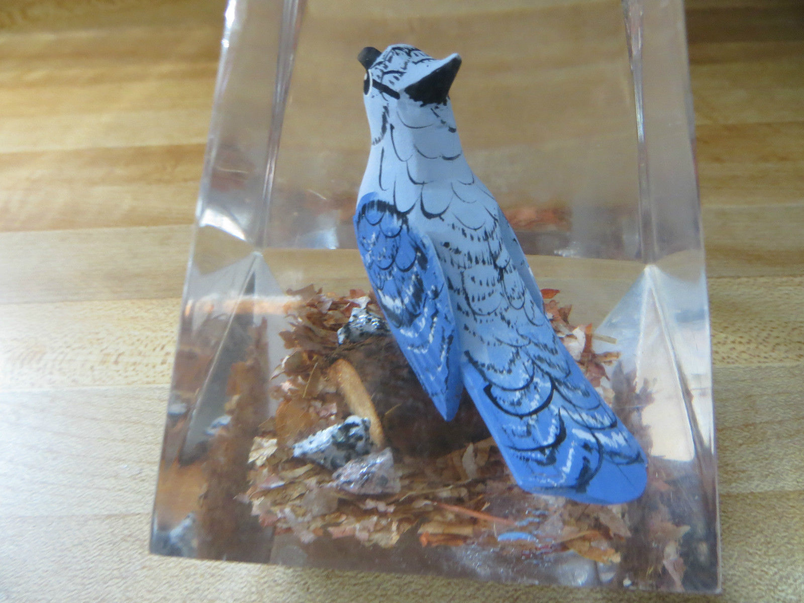 hand carved wood bluejay song bird sitting on log glass paperwieght collectible