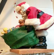 "VINTAGE SANTA CLAUS WITH BAG OF TOYS ON HEAVY CERAMIC FLOOR BASE -  10""X10"" image 4"