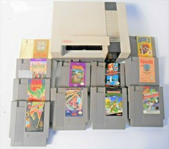 Nintendo Video Game Console & 11 Different game cartridges Model NES-001 1985 - $104.50