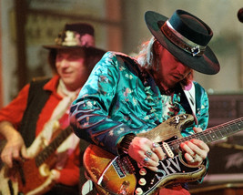 Stevie Ray Vaughan playing guitar wearing stetson 1988 16x20 Canvas Giclee - $69.99