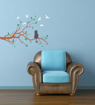 Cat patiently waits on tree branch for birds. - $26.95