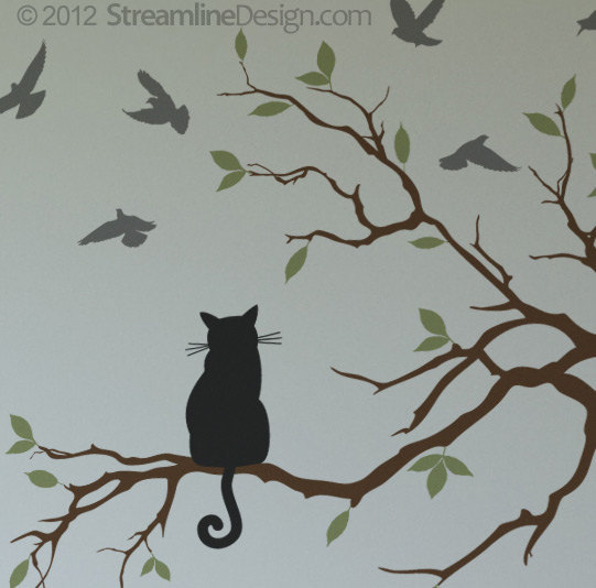Cat patiently waits on tree branch for birds.