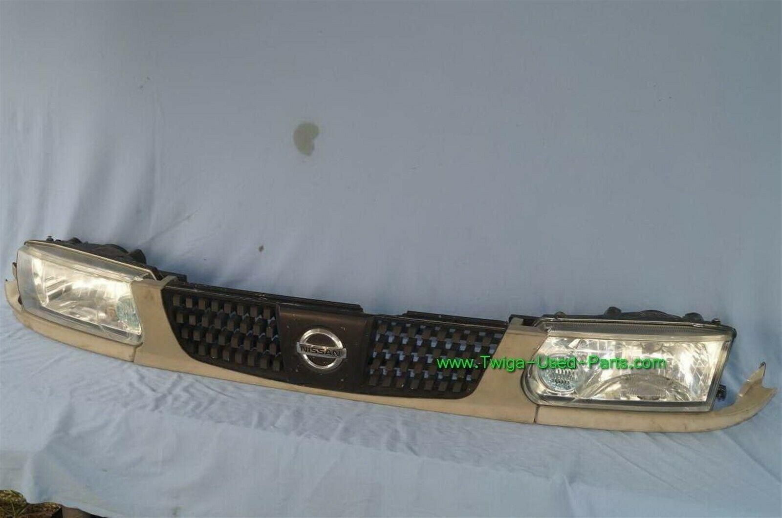 93-94 Nissan Tsuru Sunny Sentra B13 Headlights Head Light Lamps Set L&R w/ Grill