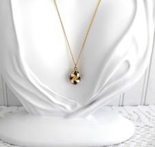 Gold Flower Easter Egg Pendant Necklace Rhinestones Black White Pinwheel... - $48.00