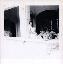 Lady Setting Pretty On The Hotel Porch Wall 1958 - $9.99